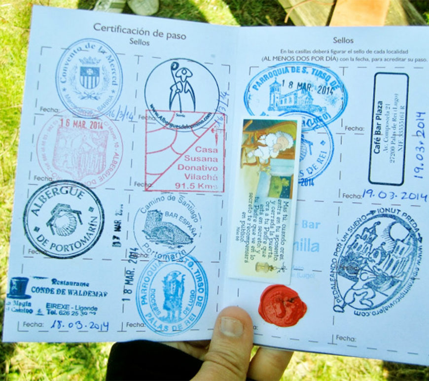 Open passport with stamps