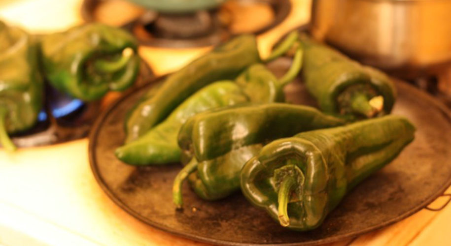 Chiles poblanos roasting on stove